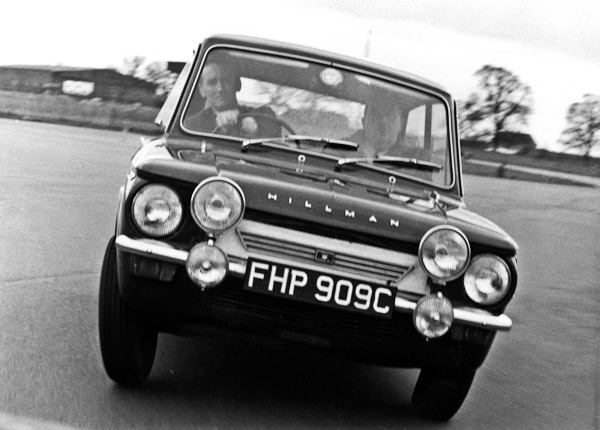 Peter Harper demonstrating an Imp to a Rootes dealer